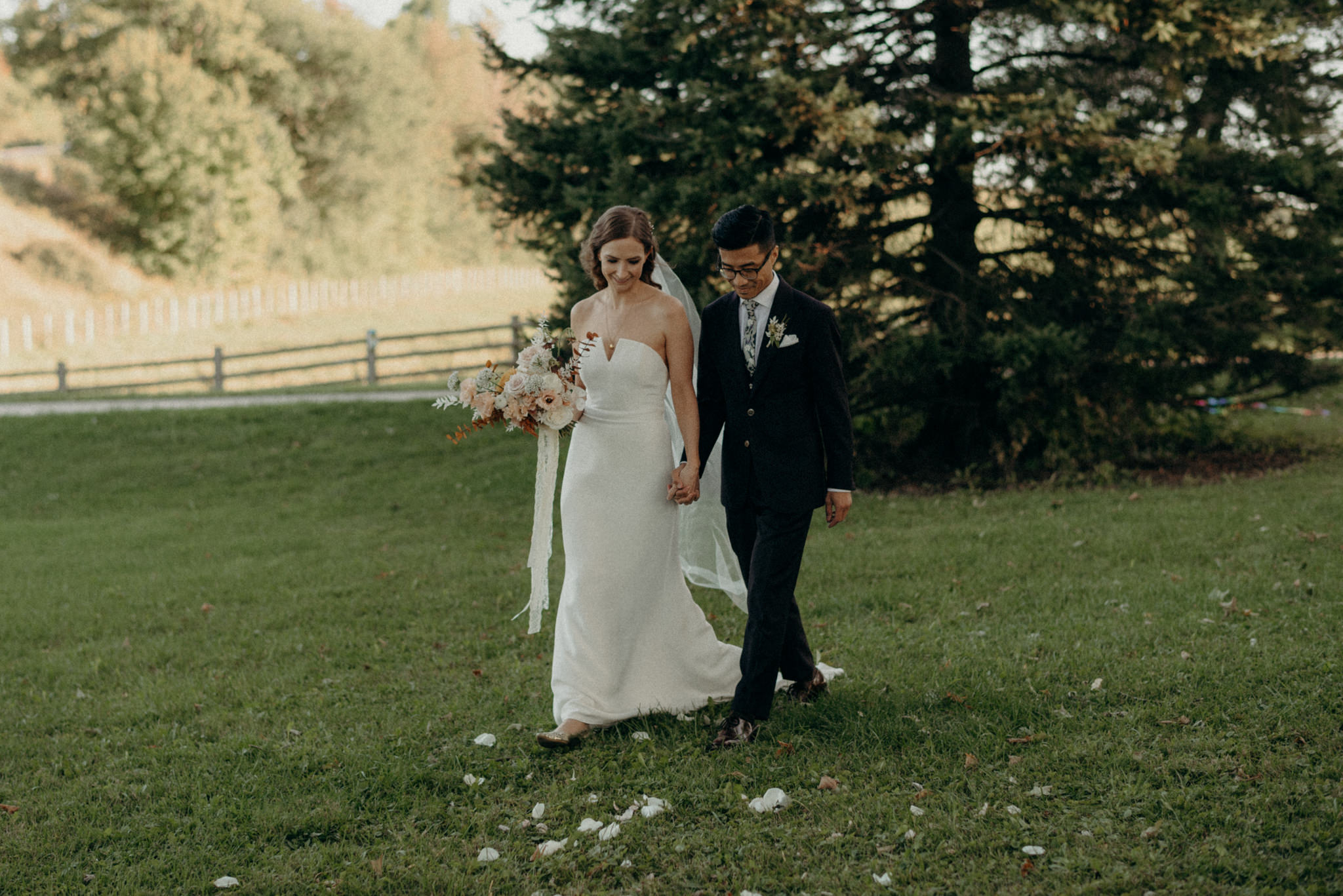 bride and groom walking holding hands down aisle