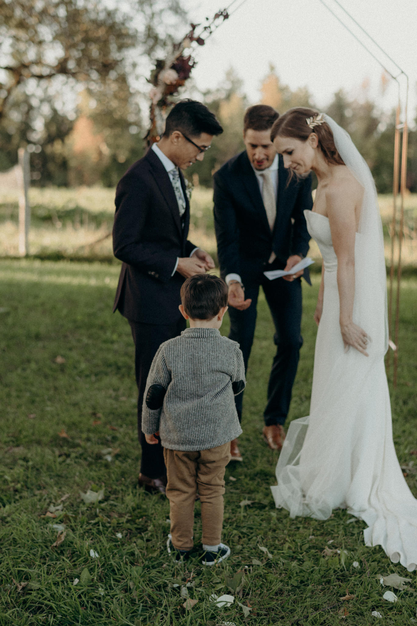 ring bearer bringing rings to couple during ceremony