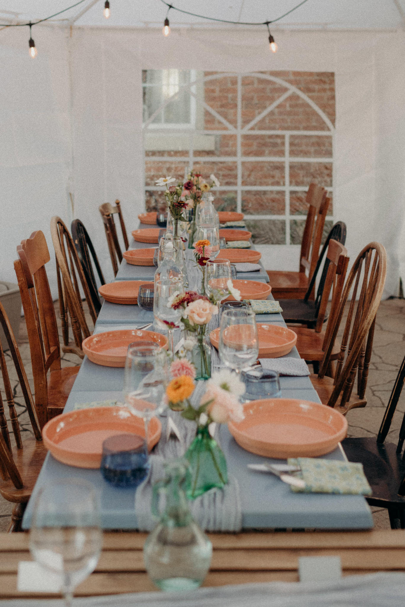Intimate tent reception, colourful table setting. Good Family Farms Wedding.