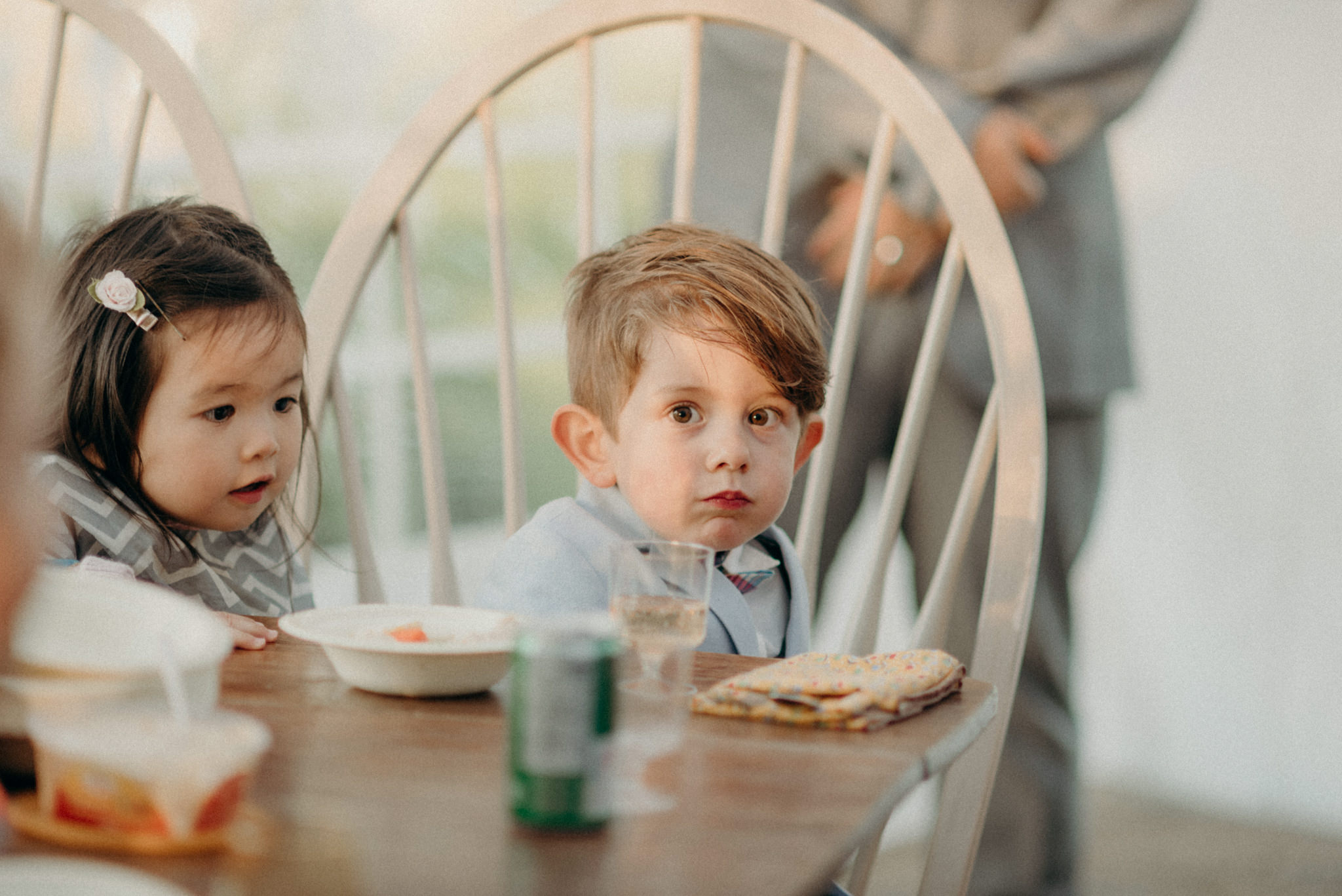 kids sitting at table at wedding reception