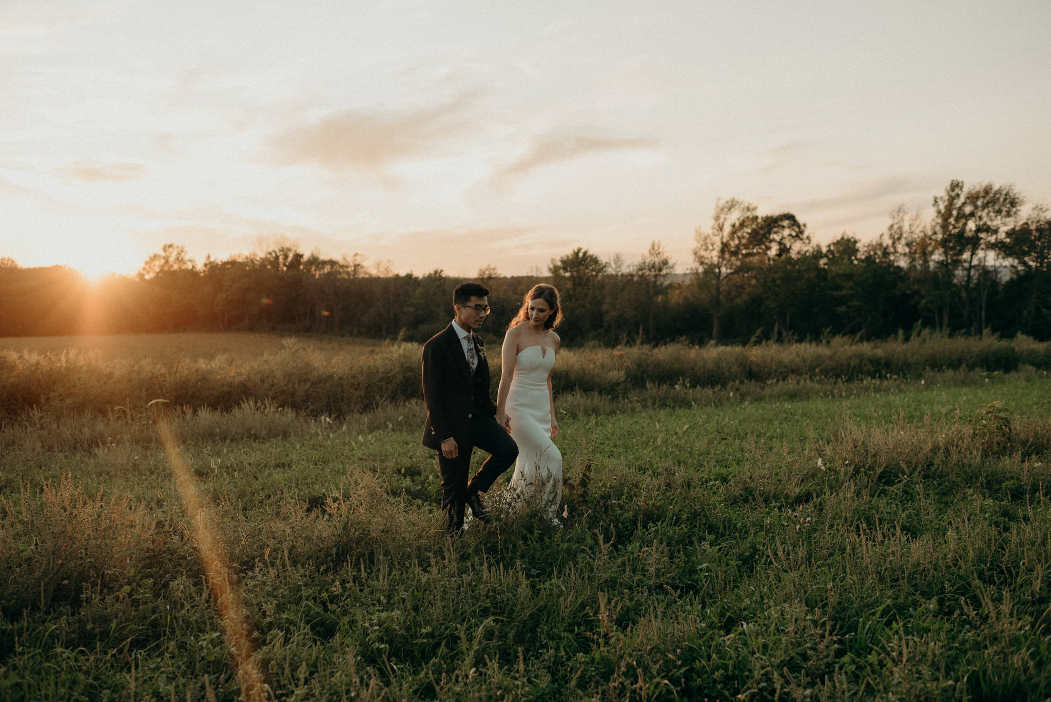 Wedding portraits in a field at sunset. Good Family Farms wedding.