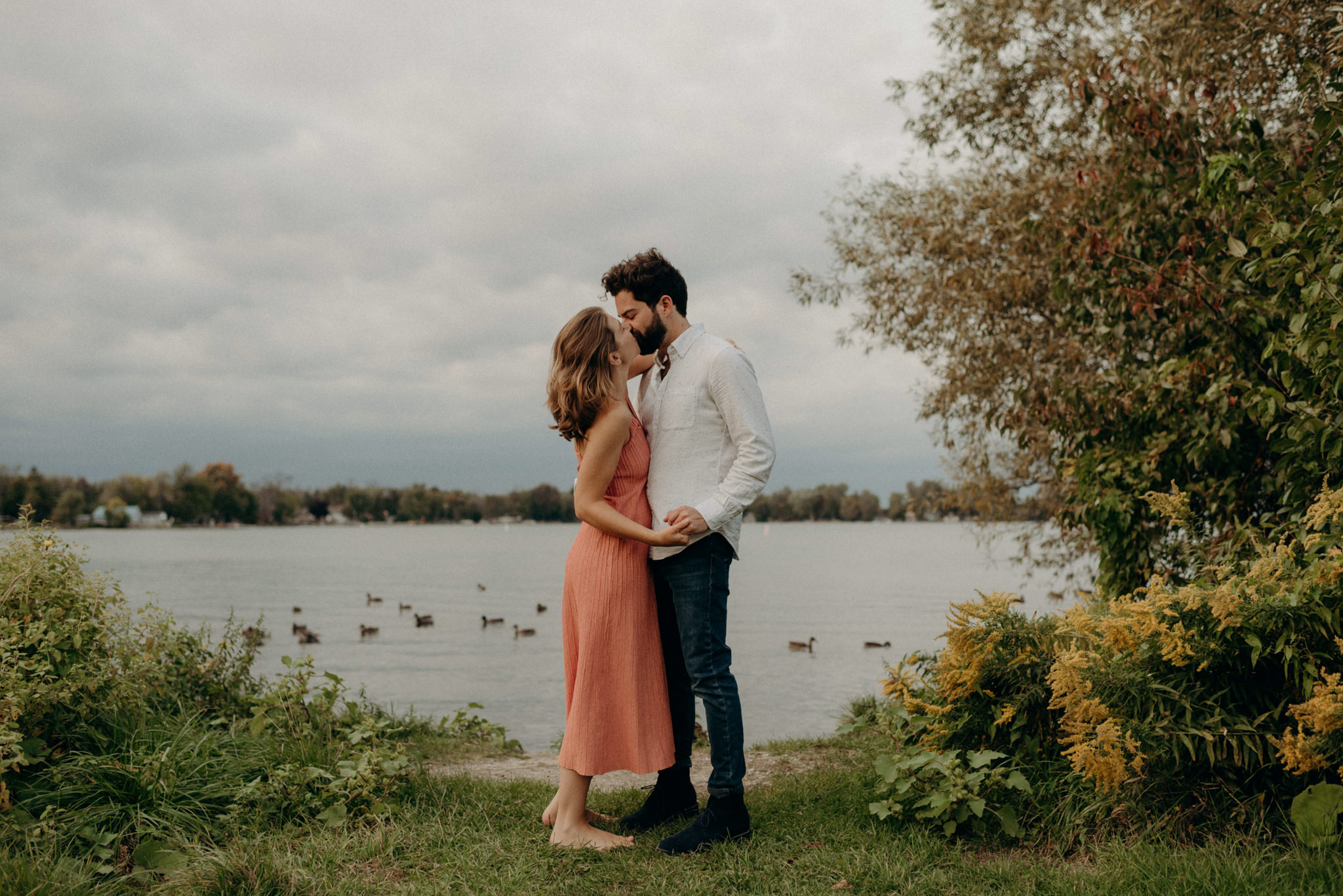 Couple kissing by the water. Innisfil Engagement shoot.