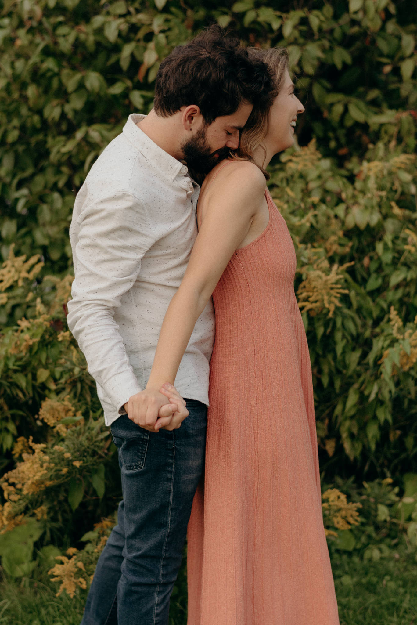 guy kissing girls shoulder