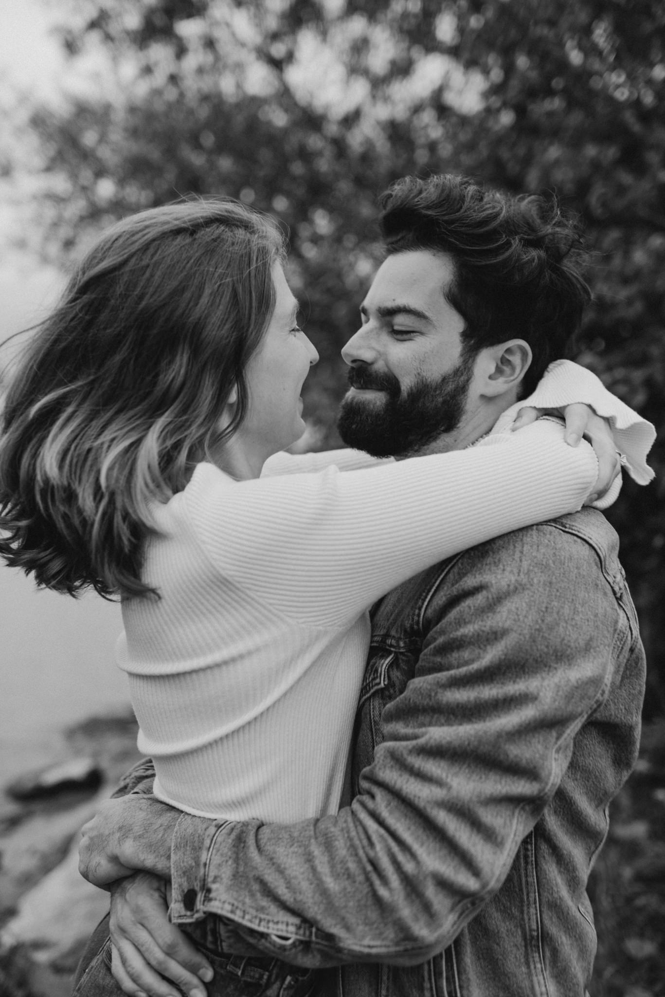 black and white portrait of couple hugging